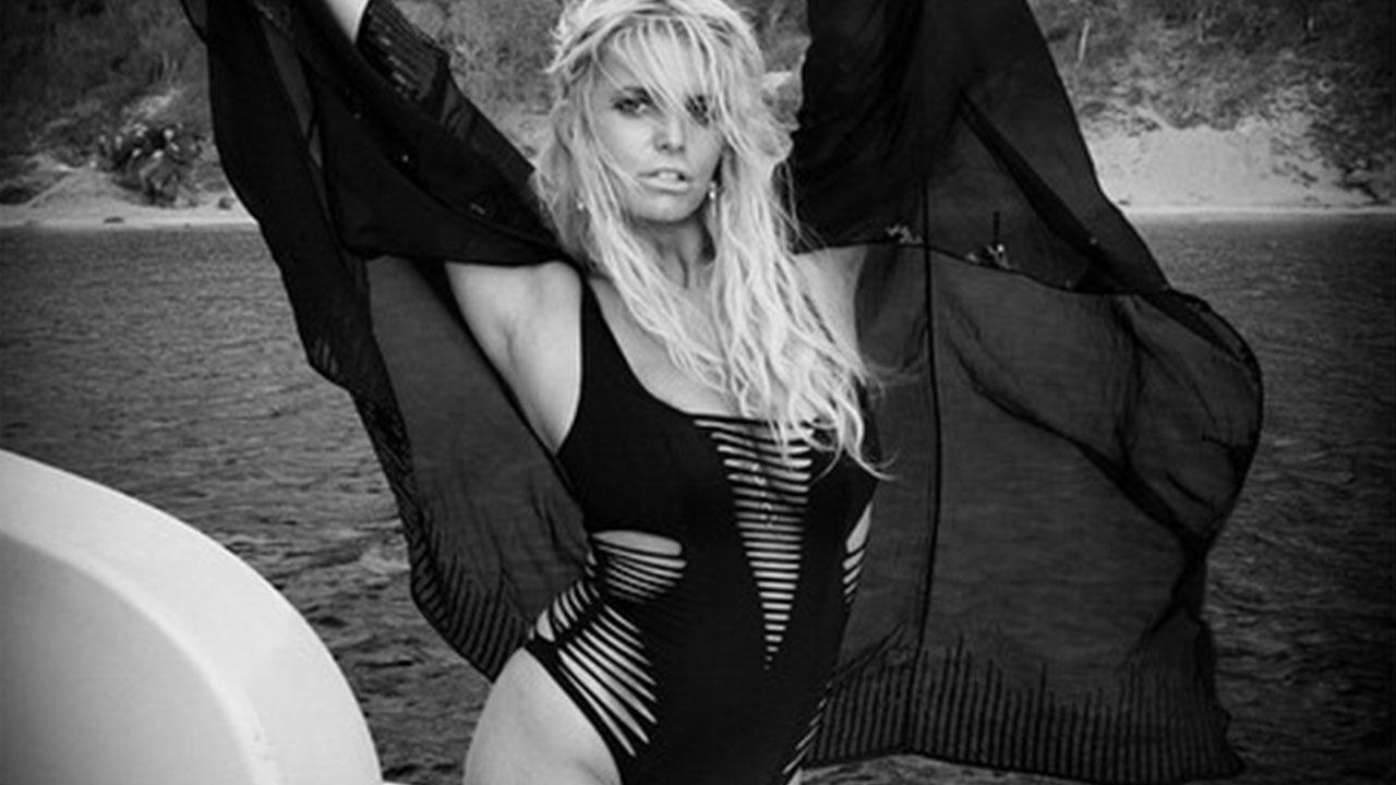 b87c988654 Jessica Simpson Sports Same Sexy Monokini as Kendall and Kylie Jenner!