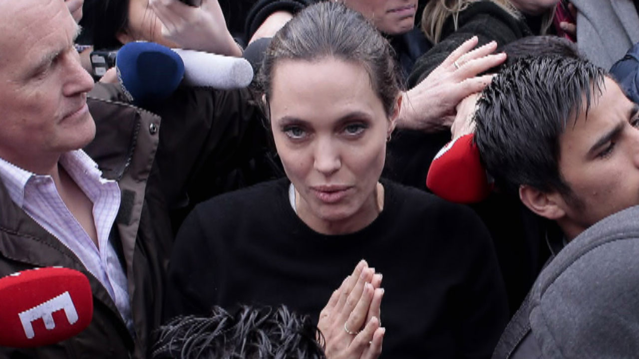Angelina Jolie Protects Children From Dangerous Mob In Greece Entertainment Tonight