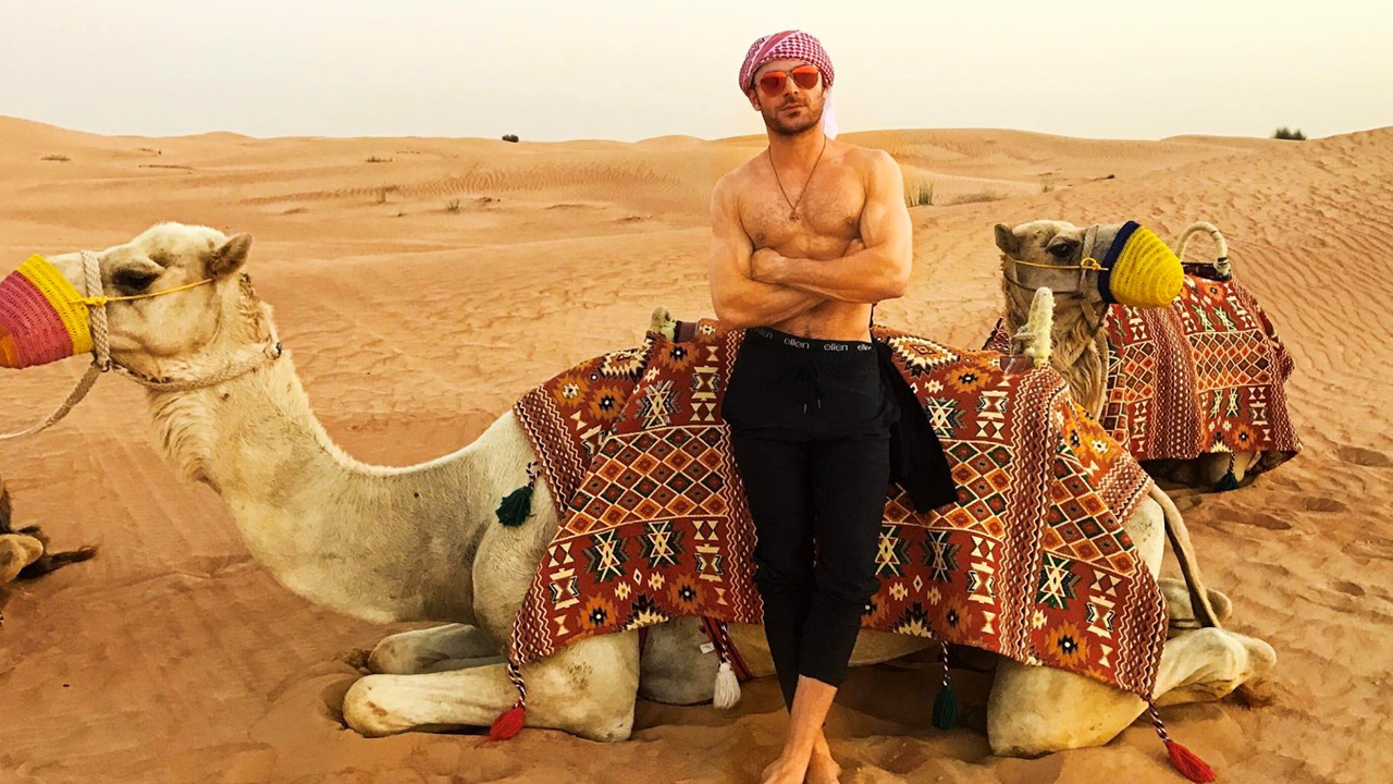 Zac efron rides a camel shirtless in dubai see the smoldering zac efron rides a camel shirtless in dubai see the smoldering pics entertainment tonight thecheapjerseys Images