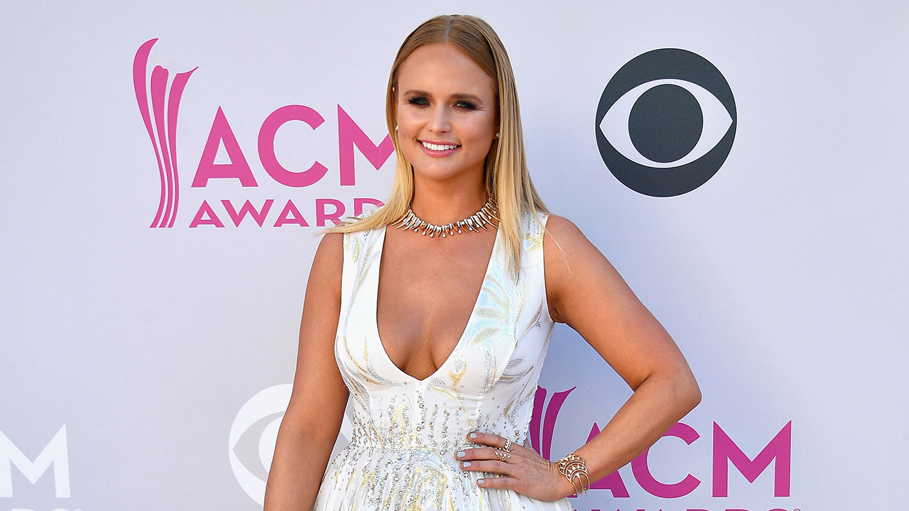 Miranda Lambert Gives f Bridal Vibes in Low Cut White Gown at