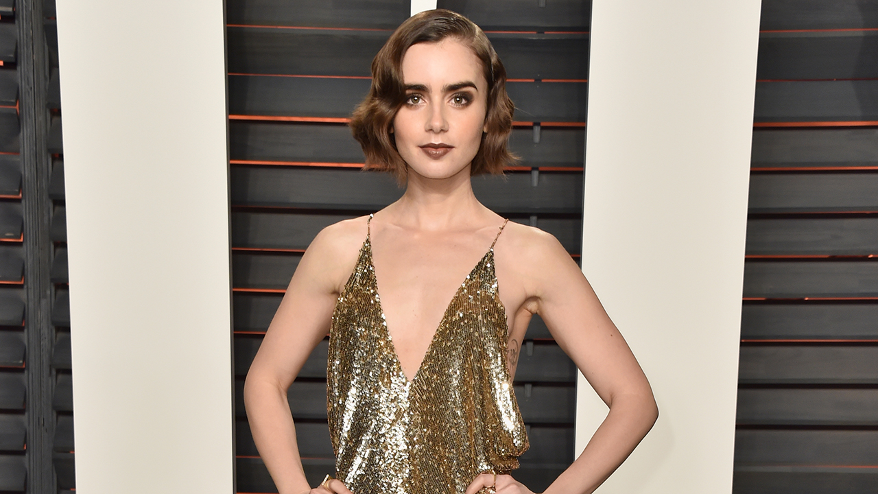 Lily Collins Strips Down To Find Perfect Gown For The
