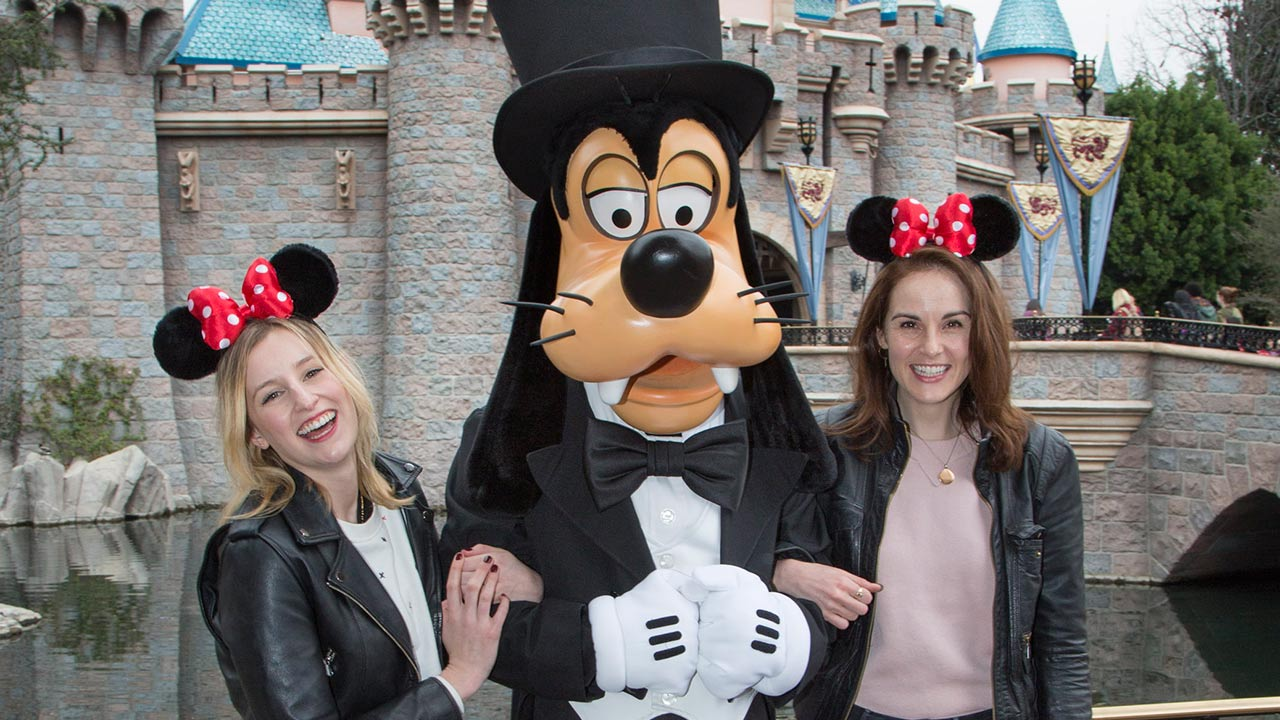 Downton Disney! Former Downton Abbey co-stars Michelle Dockery and Laura Carmichael snapped a photo with Goofy at Sleeping Beauty's Castle at Disneyland in Anaheim, California.