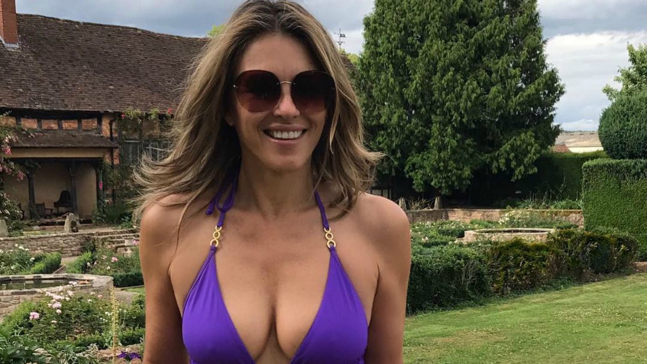Elizabeth Hurley Waters Her Lawn In A Stunning Plunging