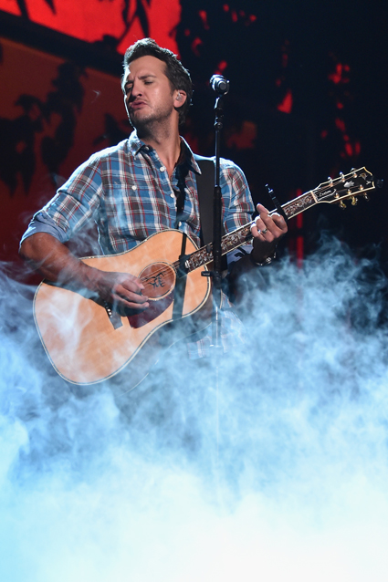 """The """"Kick Up the Dust"""" singer rocked out on a fog-covered stage at the Bridgestone Arena in Nashville, Tennessee on June 6, during the first day of rehearsals for the upcoming CMT Music Awards on Wednesday. Photo: Getty Images/Mike Coppola"""